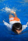 Japanese boy swimming in the pool Royalty Free Stock Photo