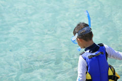 Japanese boy swimming with snorkel Stock Images