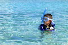 Japanese boy swimming with snorkel Royalty Free Stock Photography