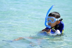 Japanese boy swimming with snorkel Stock Photography