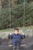 Japanese boy on the swing stock photos