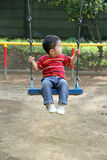 Japanese boy on the swing Stock Photos