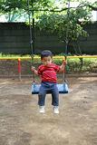 Japanese boy on the swing Royalty Free Stock Image