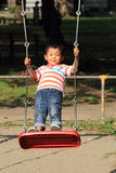 Japanese boy on a swing Royalty Free Stock Images