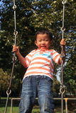 Japanese boy on a swing Royalty Free Stock Photography