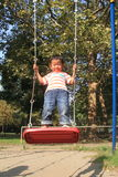Japanese boy on a swing Royalty Free Stock Photo