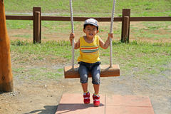 Japanese boy on the swing Stock Images