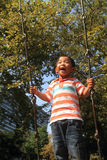 Japanese boy on a swing Stock Photos