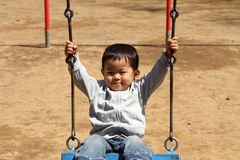 Japanese boy on the swing Stock Image