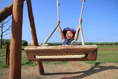 Japanese boy on the swing Stock Photo