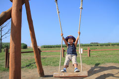 Japanese boy on the swing Royalty Free Stock Photos