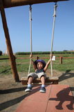 Japanese boy on the swing Stock Photography
