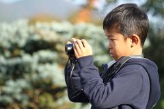 Japanese boy taking a picture Stock Image