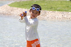 Japanese boy with water gun Royalty Free Stock Photography