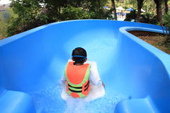Japanese boy on the water slide royalty free stock images