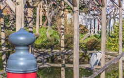 Japanese bridge giboshi and crane bird standing on a pergola in the Kameido Tenjin shrine