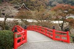 Japanese bridge and temple Royalty Free Stock Photos