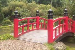 Japanese bridgre. Red japanese bridge on a garden Royalty Free Stock Images