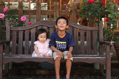Japanese brother and sister on the bench Stock Image