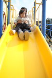 Japanese brother and sister on the slide Royalty Free Stock Photos