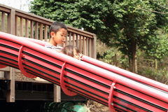 Japanese brother and sister on the slide Royalty Free Stock Images