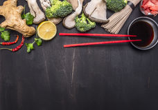 Japanese buckwheat noodles with oyster mushrooms, red chopsticks cilantro wooden rustic background stock photography