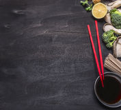 Japanese buckwheat noodles with oyster mushrooms, red chopsticks cilantro on wooden rustic background top view close up border, pl Stock Photography
