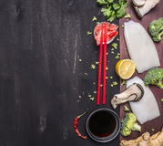 Japanese buckwheat noodles with oyster mushrooms, red chopsticks cilantro on wooden rustic background top view close up border, pl stock photo