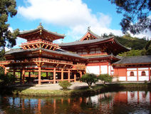 Japanese Buddhist Temple in Hawaii. Japanese Byodo-In Buddhist temple reflected in the water on a sunny day in Oahu, Hawaii Royalty Free Stock Photo