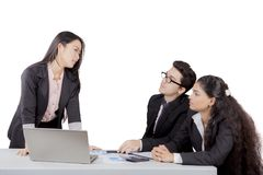 Japanese business manager talks to her staff Royalty Free Stock Image