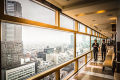 Japanese Business Men. Two Japanese business men with a view of Tokyo Royalty Free Stock Photo