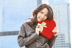 Japanese business woman with a heart Royalty Free Stock Photos