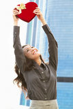 Japanese business woman with a heart held high Royalty Free Stock Image