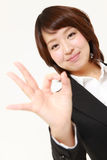 Japanese Business woman showing perfect sign Royalty Free Stock Images