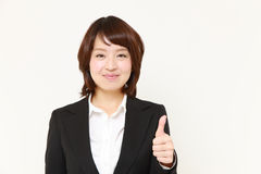 Japanese Business woman showing thumbs up gesture Stock Image