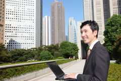 Japanese businessman with computer  Royalty Free Stock Images