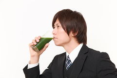 Japanese businessman with green vegetable juice Stock Photos