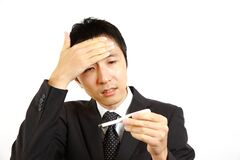 Japanese businessman having fever Stock Images