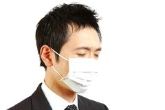 Japanese businessman with mask. Concept shot of Japanese businessman stock images