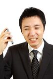 Japanese businessman receives complaint call Stock Photos