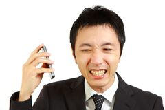 Japanese businessman receives complaint call stock photography