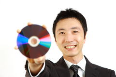 Japanese businessman showing a media disc Royalty Free Stock Image