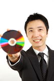 Japanese businessman showing a media disc Royalty Free Stock Images
