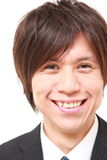 Japanese businessman smiles Royalty Free Stock Images