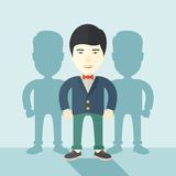 Japanese businessman standing straight with his. A very confident japanese guy standing straight showing that he has a strong teambuilding togetherness. Teamwork Royalty Free Stock Image