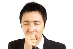 Japanese businessman suffer from a bad cough  Stock Photo