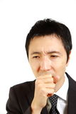 Japanese businessman suffer from a bad cough  Royalty Free Stock Image