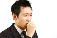 Japanese businessman suffer from a bad cough  Stock Photos