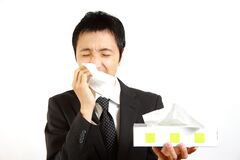 Japanese businessman suffer from a runny nose Stock Photo
