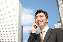 Japanese businessman talks with a mobile phone Stock Image